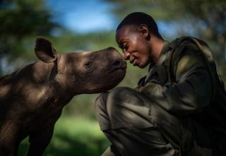 Conservation ranger and the baby black rhino