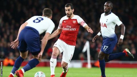 Henrikh Mkhitaryan in action for Arsenal against Tottenham