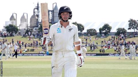 New Zealand batsman BJ Watling raises his bat as he walks off after hitting 205 against England in the first Test