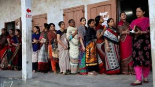 Voters wait to cast their ballots in Dhaka