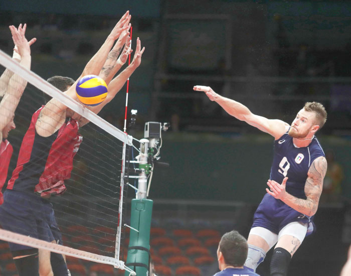 Ivan Zaytsev of Italy spikes the ball against the US during their volleyball semifinals match of the 2016 Rio Games Friday. — Reuters