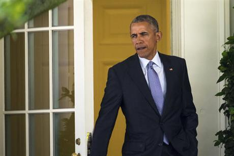 President Barack Obama steps out of the Oval Office of the White House in Washington Friday Aug. 26 2016 as he departs for a quick trip to Walter Reed National Military Medical Center in Bethesda Md to visit with wounded service members. (AP
