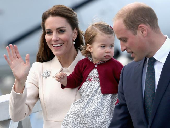 The Duke and Duchess of Cambridge with Princess Charlotte wave to the crowds. Picture: Chris Jackson/Getty Images