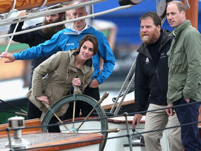 """She's the skipper. Kate helms the tall ship Pacific Grace in Victoria Harbour as """"First Mate"""" William looks on. Picture: Chris Jackson/Getty Images"""