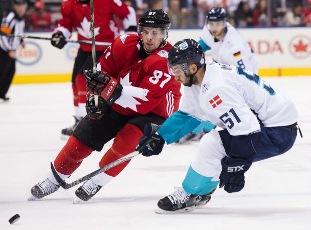 Team Canada centre Sidney Crosby battles for the puck against Europe centre Frans Nielsen during the third period of Canada's 3-1 win in game 1 of the World Cup of Hockey best-of-three final in Toronto Tuesday