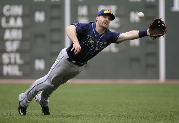 Rays second baseman Logan Forsythe dives but can't make a play on a single by Boston Red Sox's Sandy Leon in the fourth inning