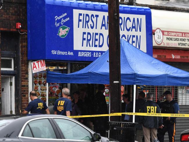 Investigators with the Federal Bureau of Investigation (FBI) search inside the family restaurant and adjoined apartment of Ahmad Khan Rahami in Elizabeth, New Jersey, on September 19, 2016. Picture: AFP.