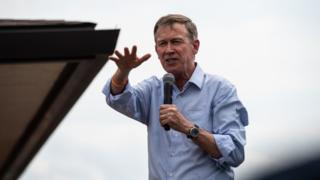 Mr Hickenlooper speaks to voters at the Iowa State Fair in August
