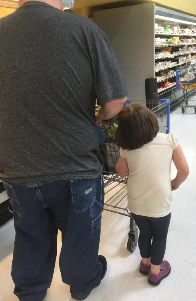 The father can clearly be seen to pulling his daughter's hair as they shop in Cleveland, Ohio. Picture: Erika Burch / Facebook