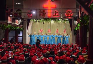 People attending a Christmas Eve event at a church in Fuyang, China's eastern Anhui province