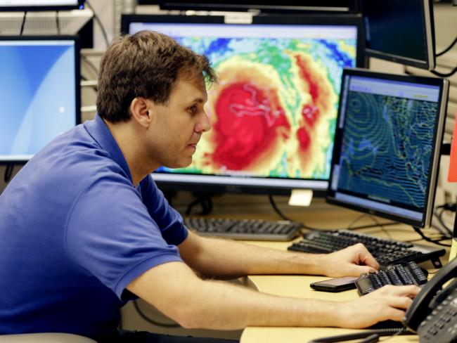 Hurricane specialist Eric Blake monitors the path of Hurricane Matthew at the National Hurricane Centre. Picture: AP