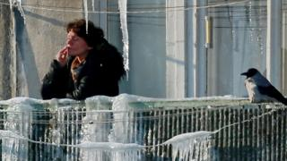 File pic of Russian woman smoking in the winter