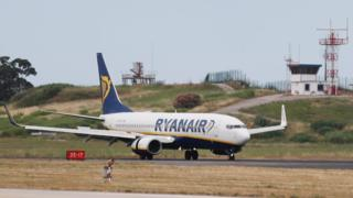 A Ryanair plane lands at Lisbon airport