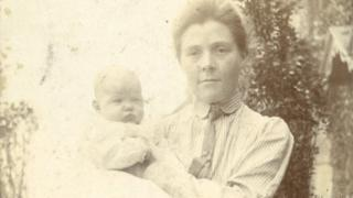 Olive with her son, John, in a garden