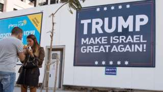 This file photo taken on November 15, 2016 shows a placard reading Trump Make Israel Great Again in Tel Aviv.