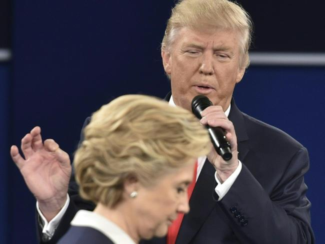 Donald Trump and Hillary Clinton trade words during the second presidential debate. Picture: Paul J. Richards/AFP