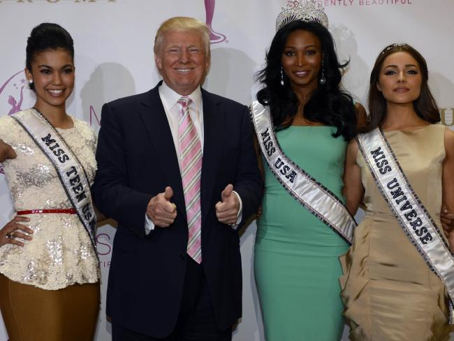 Donald Trump with Miss USA Nana Meriwether (C), Miss Universe Olivia Culpo (L) and Miss Teen USA Logan West. Picture: AFP