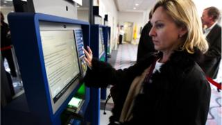 Woman using global entry system