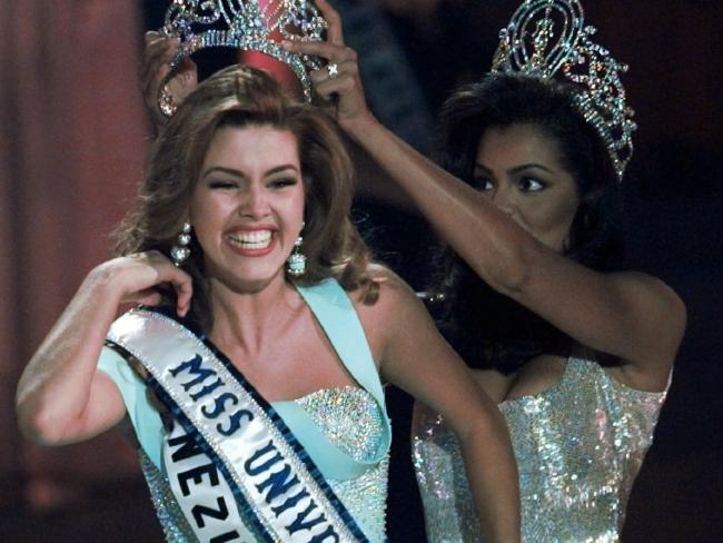 In this May 17, 1996, file photo, the new Miss Universe Alicia Machado of Venezuela reacts as she is crowned by the 1995 winner Chelsi Smith at the Miss Universe competition in Las Vegas. Picture: AP