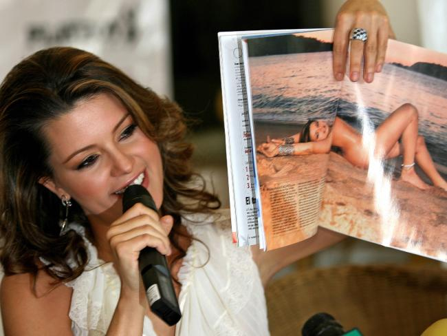 This file photo taken on February 7, 2006 shows Venezuelan Alicia Machado, former Miss Universe 1996, as she holds February's issue of Playboy Mexico magazine open in a double page with her picture in Mexico City. Picture: AFP