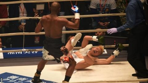 Mayweather was smiling as he floored Nasukawa three times in the opening round