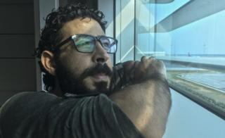 Hassan al-Kontar looks out at the airport runway from the KLIA2 transit terminal