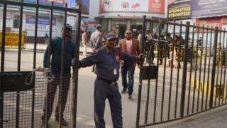 An Indian security guard stands outside a cinema, which is not screening Bollywood film Padmaavat due to threats of violence by Hindu hardliners, in Allahabad on January 25, 2018.