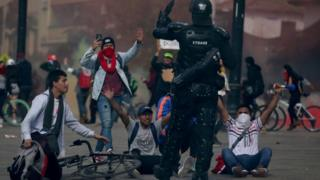 Demonstrators react during a protest at Bolivar Square in Bogota, Colombia