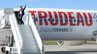 Liberal leader Justin Trudeau enters one of his campaign planes