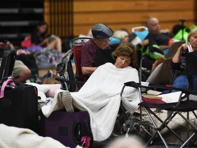 Local residents have taken shelter in a high school in Florida. Picture: AFP PHOTO / Jewel SAMAD