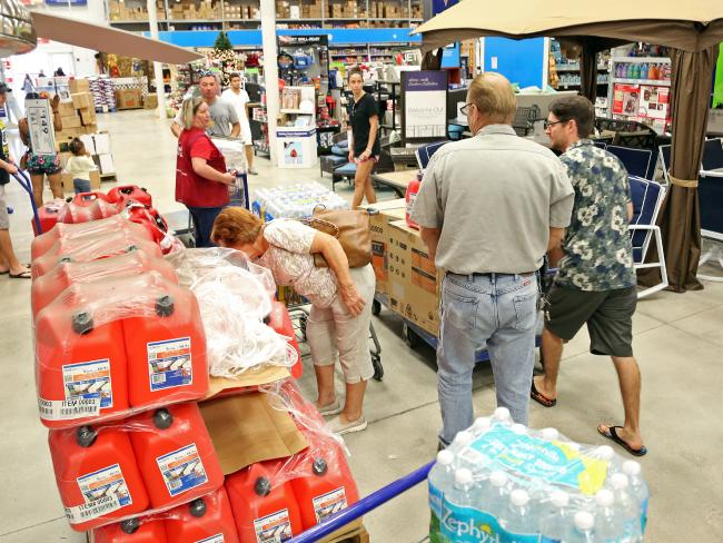 Shoppers stock up on water, gas and generators in Florida. Picture: Amy Beth Bennett/South Florida Sun-Sentinel via AP.